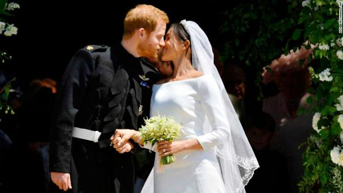 Harry and Meghan kiss on the steps of St. George's Chapel in Windsor Castle after their wedding.