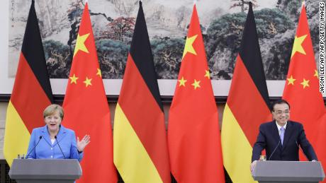 Chinese Premier Li Keqiang (R) and German Chancellor Angela Merkel attend a joint news conference at the Great Hall of the People in Beijing on May 24, 2018.