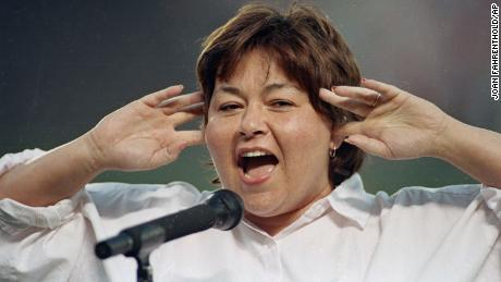 Roseanne Barr holds as she screams the National Anthem in 1990.