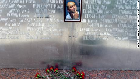 Flowers lie under a picture of Babchenko placed on the memorial wall of Moscow's journalists house before he was revealed to be alive.