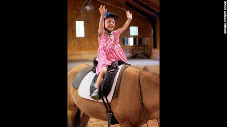 Seven-year-old Belle Swersey on her first day of riding lessons at Friends for Tomorrow in Lincoln, Massachusetts.