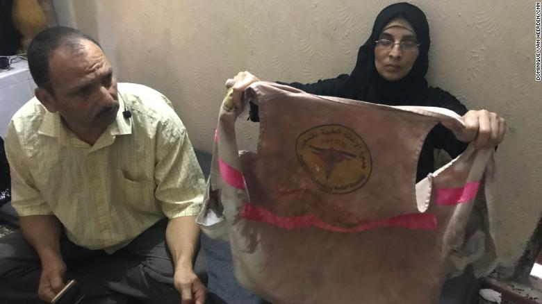 Ashraf and Sabreen al-Najjar display their daughter's bloodied medical vest.