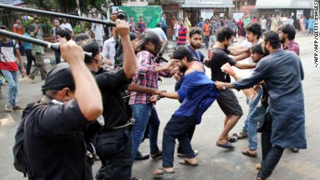 This photograph taken on June 6 shows members of the Rapid Action Battalion (RAB)  baton-charging secular activists for protesting against alleged extrajudicial killings during the country's ongoing anti-drug drive, in Dhaka.