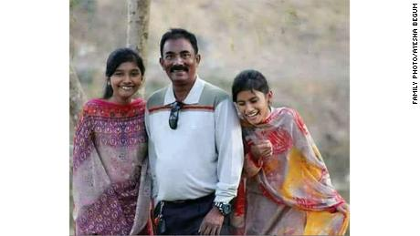 Akramul Haque and his two daughters