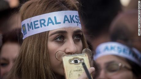 A supporter listens to Aksener speaking at a rally in Gaziantep, Turkey.