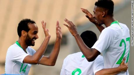 Saudi Arabia midfielder Mohamed Kanno celebrates scoring against Greece in a World Cup warm up.