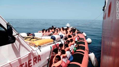 Italian official warns migrant ships not to dock as migrant supporters rally in Rome