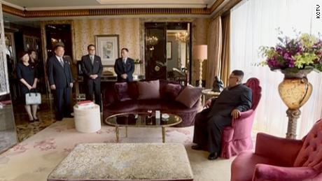 The video showed Kim surrounded by aides at the St. Regis Hotel, Singapore.