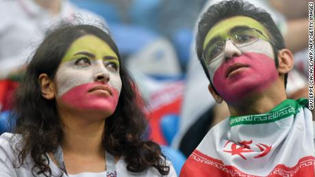 Iran supporters look on prior to the  clash against Morocco.
