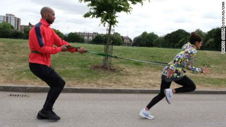 Ali -- pictured here training with Fabian Collymore -- fell in love with boxing after her mother got her a membership to a local sports center in a bid to boost her confidence.