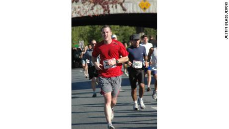 Justin Blazejewski running a marathon before an ankle injury left him unable to run long distances.