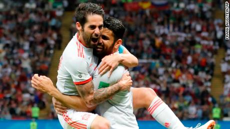 Diego Costa celebrates his winning goal with Isco.