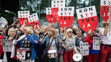 """Demonstrators protest against Poland's new """"Law on the Supreme Court"""" in Warsaw in July."""