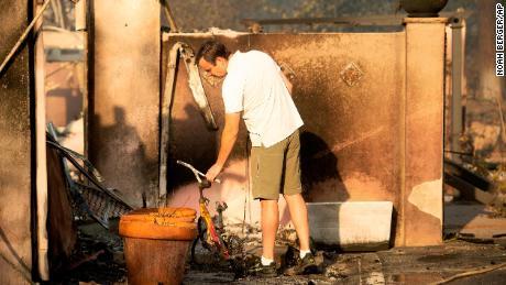 Eric Durtschi surveys the remains of his home in Goleta.