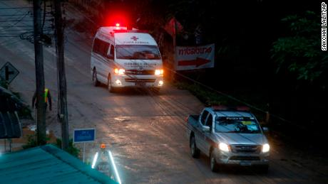 An ambulance leaves the cave in northern Thailand hours after operation began to rescue the trapped soccer players and their coach.