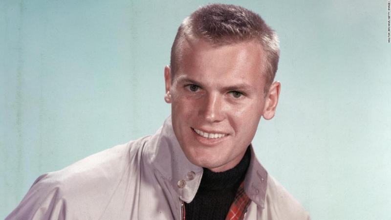 "<a href=""https://www.cnn.com/2018/07/09/entertainment/tab-hunter-dead/index.html"" target=""_blank"">Tab Hunter</a>, who rose to fame as a Hollywood heartthrob in the 1950s, died July 8, his partner Allan Glaser confirmed to CNN. He was 86."