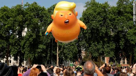 "A six-meter ""Trump Baby"" blimp flies in Parliament Square in London on Friday."