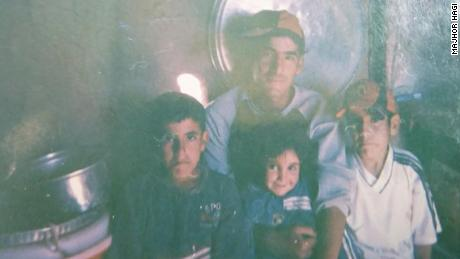 Majhor with his younger siblings in Shingal in 2009.