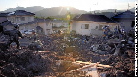 Japan Self-Defense Force members conduct search operations Wednesday in Kumano, Hiroshima.