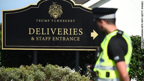 A police officer stands guard outside Trump Turnberry.