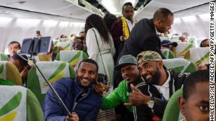 Selfies and roses as Ethiopians board first flight to Eritrea in 20 years