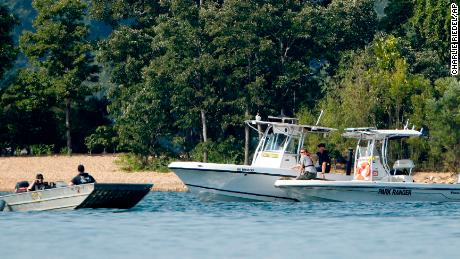 Emergency workers patrol an area Friday near where the duck sank to Table Rock Lake. near the place where the duck sank at Table Rock Lake