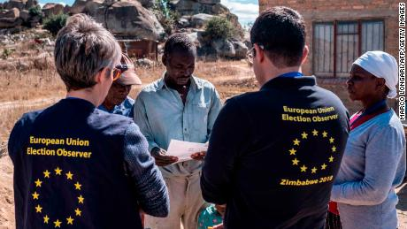 Members of a European Union election observation team speak to voters in Nyatsime, on July 24, 2018.