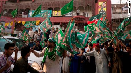People gather outside an election office of a candidate Wednesday as polls closed in Rawalpindi.