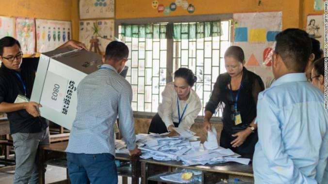 Voting officials in Cambodia count ballots Sunday.