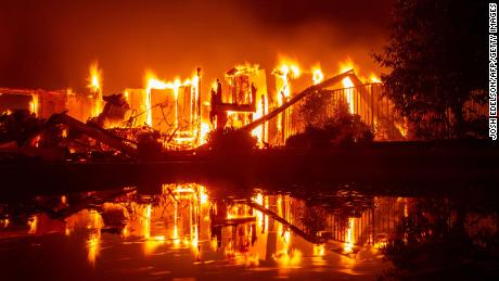 A house is caught up in the Carr fire in Redding, California, on July 27.
