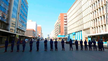 Police block the road leading to the opposition offices in Harare on Thursday.