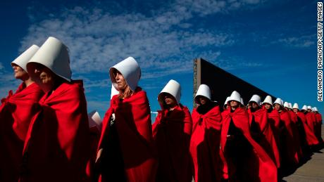 "Activists in favor of legalizing abortion march in Buenos Aires dressed as women from Margaret Atwood's ""The Handmaid's Tale."""