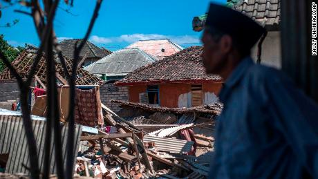 A man inspects the damage in Kayangan, on Lombok Island.