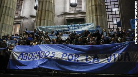 Anti-abortion activists rally in front of the Faculty of Law of the University of Buenos Aires, Argentina.