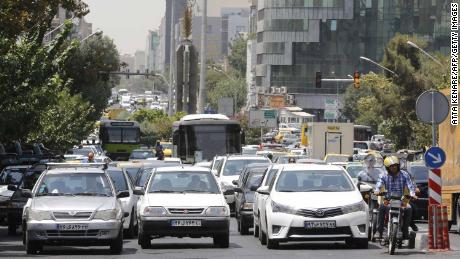 Iranian drivers stop at a junction on a main street in the capital Tehran.