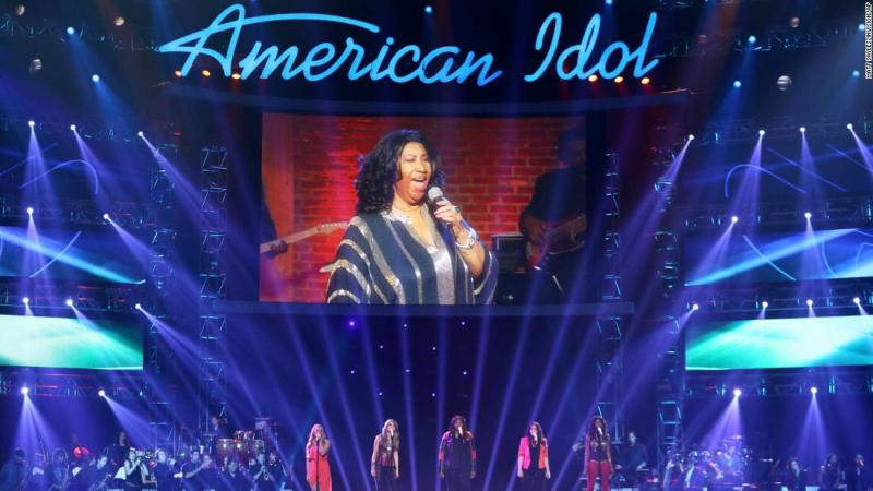 """Franklin, seen on screen, at the """"American Idol"""" finale in 2013."""