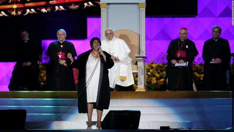 Pope Francis looks on as Franklin performs during the 2015 Festival of Families in Philadelphia, Pennsylvania.