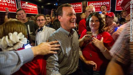 Minnesota gubernatorial candidate Jeff Johnson, center, is greeted by his supporters after returning to the watch party, Tuesday, Aug. 14, 2018.
