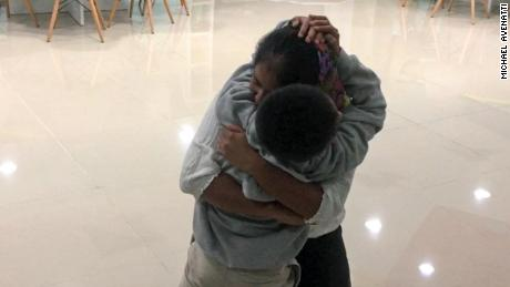 Anthony Ortiz, 9, and his mother reunite Tuesday night in their native Guatemala.