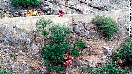 Rescue teams work at the gorge Monday in Pollino National Park.