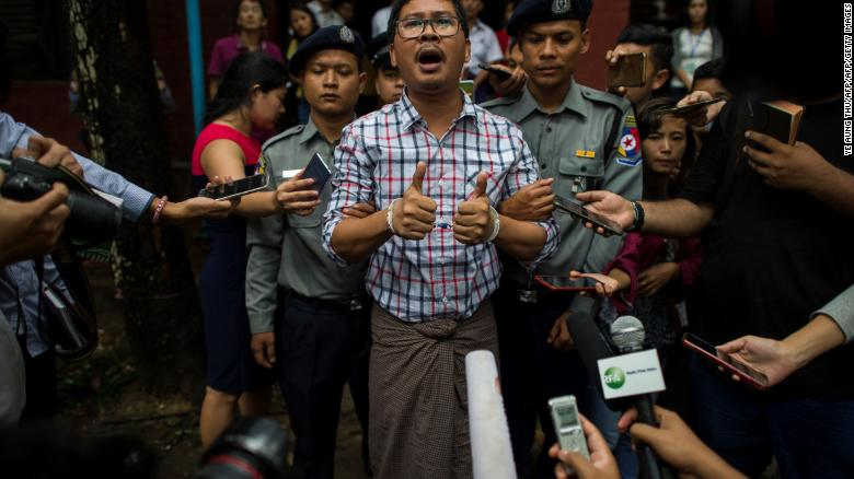 Detained Reuters journalist Wa Lone speaks to journalists after appearing before a court trial in Yangon in August 2018.
