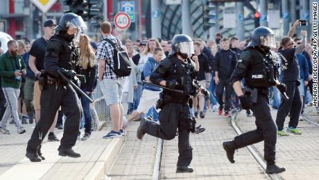 Riot police in Chemnitz on Sunday as far-right protesters marched in the streets.