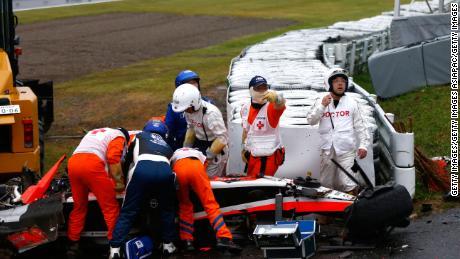 Jules Bianchi receives urgent medical treatment after crashing during the Japanese Grand Prix.