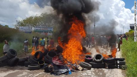 Residents of the Brazilian border town of Pacaraima burn tires and belongings of Venezuelans immigrants after attacking their two main makeshift camps, leading them to cross the border back into their home country earlier in August.