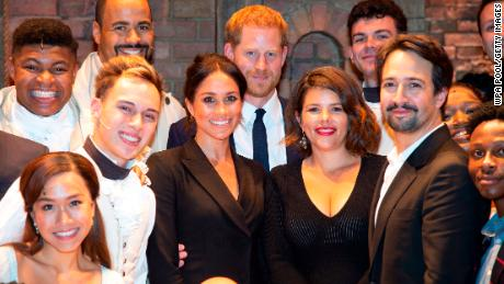 """(L-R) Meghan, Duchess of Sussex (C), Prince Harry, Duke of Sussex, Vanessa Nadal, and playwright Lin Manuel Miranda meet the cast and crew of """"Hamilton"""" backstage."""