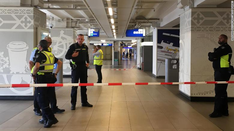 Security officials cordon off an area inside the central railway station in Amsterdam.