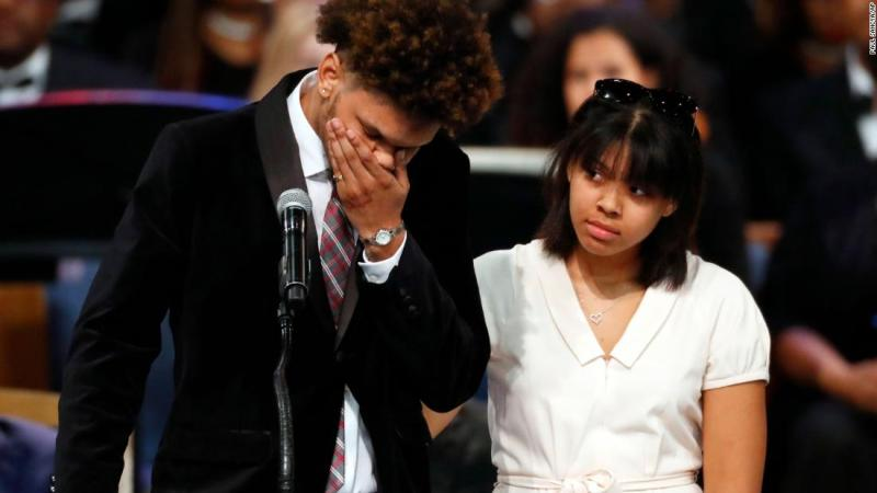 Jordan Franklin, Franklin's grandson, pauses alongside his sister Victorie while speaking at the funeral on Friday.