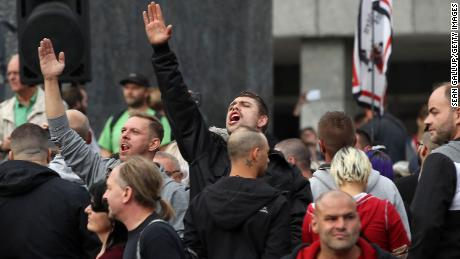 A man raises his arm in a Heil Hitler salute at a protest in Chemnitz last Monday.