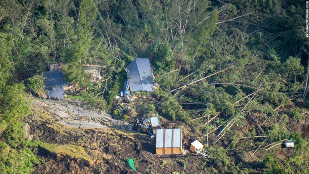 This picture shows an aerial view of houses damaged by a landslide in Atsuma town, Hokkaido prefecture on September 6, 2018, after an earthquake hit the northern Japanese island of Hokkaido.