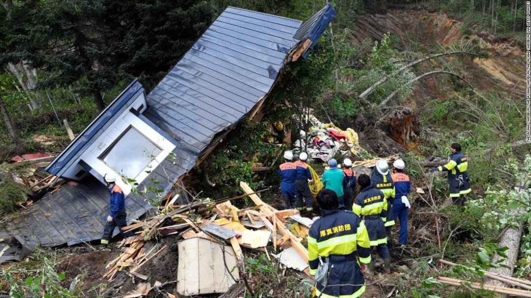 A rescue operation is conducted at a house destroyed by a landslide after a powerful earthquake on September 6, 2018 in Atsuma, Hokkaido, Japan.